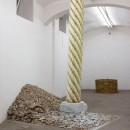 Mircea Cantor |  Vertical Aleppo | 2017 | Aleppo soap, aerated concrete, iron |  Column height: 370 cm; diameter: 49 cm Rubble base: 200 x 323 x 83 cm |  Exhibitions: Your Ruins are My Flag, Fondazione Giuliani, Rome, 2017
