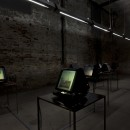 Elisabetta Benassi | The Innocents Abroad |  2011 | 9 automatized microfiche readers, microfiche, tables , neon  lights, electronic unit, electric wires |  Each Unit 140 x 60 x 60 cm | Installation view at the 54th Venice Biennale, curated by Bice Curiger, Corderie dell'Arsenale, Venice | Collection Matteo Viglietta S.p.A., Collezione La Gaia, Busca, Cuneo | Courtesy Photo © Claudio Abate